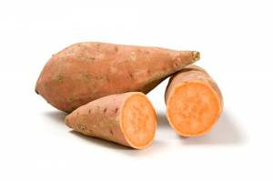 whole and halved sweet potatoes